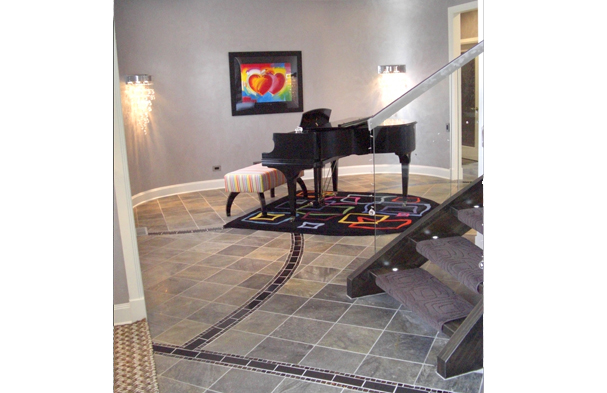 A simple Music Room. The goal was to take a space that was open to the foyer and do something special that wasn't more seating.