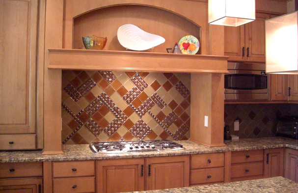 This photo features a Vienese inspired backsplash pattern from the early 20th century made of all glass.