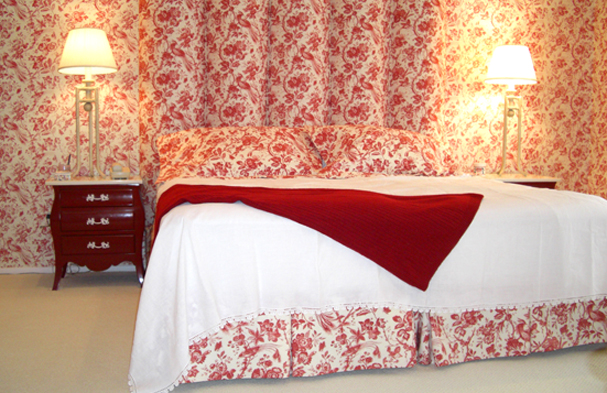 A red and white Toile traditional pattern blended into something very quiet for this master bedroom.