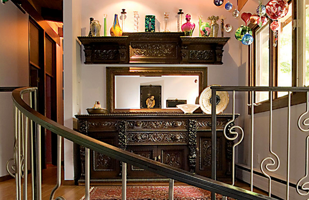 This simple but transitional railing created an eclecticism that complements the antique furniture that the client treasured.